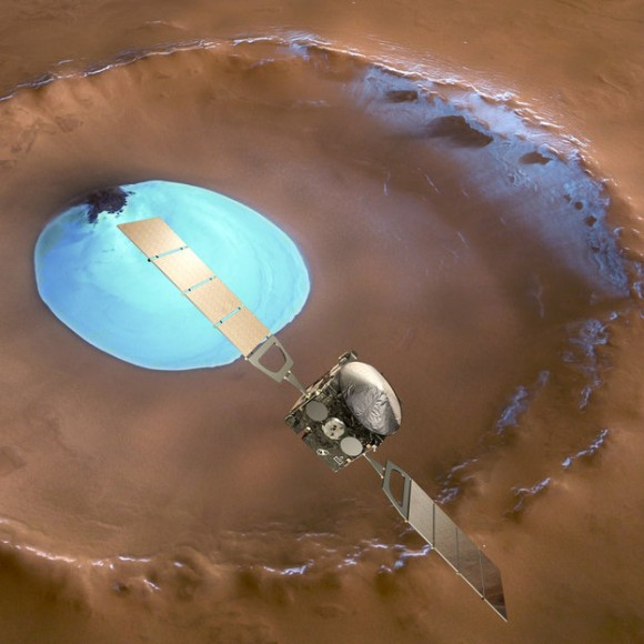 Mars Express over water-ice crater.  ESA Celebrates 10 Years since the launch of Mars Express. This artists concept shows Mars Express set against a 35 km-wide crater in the Vastitas Borealis region of Mars at approximately 70.5°N / 103°E. The crater contains a permanent patch of water-ice that likely sits upon a dune field – some of the dunes are exposed towards the top left in this image. Copyright ESA/DLR/FU-Berlin-G.Neukum