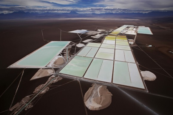 An aerial view of the brine pools and processing areas of the Soquimich lithium mine on the Atacama salt flat, the largest lithium deposit currently in production, in the Atacama desert of northern Chile, on Jan. 10, 2013. Credit: Ivan Alvarado / Reuters.