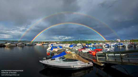 Double rainbow over a marina in Sweden on August 19, 2013. Credit and copyright: Göran Strand