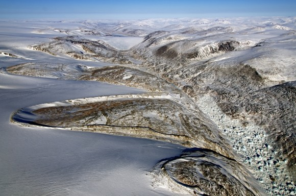 Horseshoe-shaped lateral moraines at the margin of the Penny Ice Cap on Baffin Island, Nunavut, Canada. Lateral moraines are accumulations of debris along the sides of a glacier formed by material falling from the valley wall. Credit: NASA / Michael Studinger