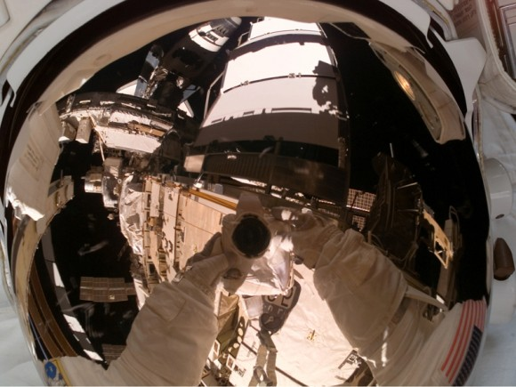 Rick Mastracchio takes a selfie during a spacewalk on STS-118. NASA's web page says the purpose was to have a photo of his helmet visor. Credit: NASA