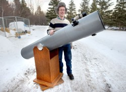 """The writer with his 10-inch Dobsonian reflecting telescope. The scope comes in two pieces like John Dobson's original design - a cardboard tube with the optics that sits in a cradle. See photo below to see how a """"Dob"""" works. Credit: Bob King"""