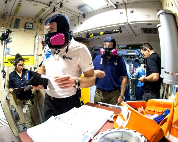 European Space Agency astronaut Alexander Gerst (left, in mask) and NASA astronaut Reid Wiseman during fire drill training for the International Space Station at NASA's Johnson Space Center in Houston. The duo were in training for their Expedition 40/41 mission, set to launch in May 2014. Credit: NASA