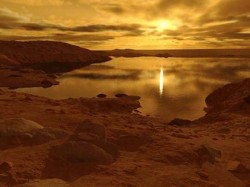 Seasonal winds may be finally kicking up waves in Titan's lakes. (Illustration © Ron Miller.)