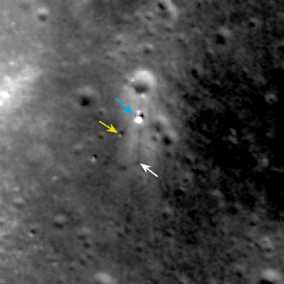 LROC February 2014 image of Chang'e 3 site. Blue arrow indicates Chang'e 3 lander; yellow arrow points to Yutu (rover); and white arrow marks the December location of Yutu. Yutu's tracks can be followed clockwise around the lander to its current location. Image width 200 meters (about 656 feet).  Credit:  NASA/Goddard/Arizona State University