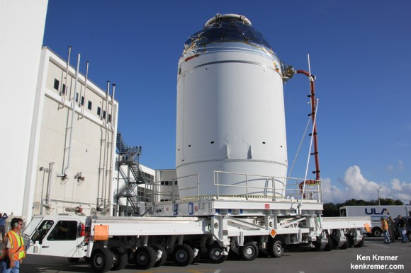 NASA's completed Orion EFT 1 crew module loaded on wheeled transporter during move to the Payload Hazardous Servicing Facility (PHFS) on Sept. 11, 2014 at the Kennedy Space Center, FL.  Credit: Ken Kremer - kenkremer.com