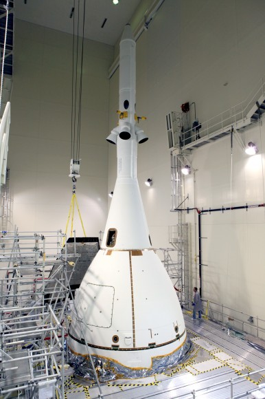 Technicians complete final assembly of NASA's first Orion spacecraft with installation of the  last ogive close out panels on the Launch Abort System that smooth airflow. Credit: Photo credit: Kim Shiflett