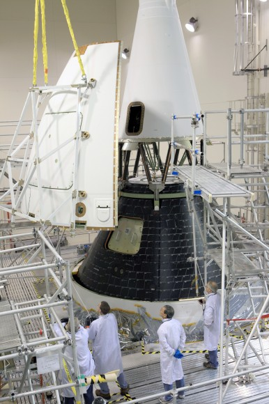 Technicians complete final assembly of NASA's first Orion spacecraft with installation of the  close out panels on the Launch Abort System that smooth airflow. Credit: Photo credit: Kim Shiflett