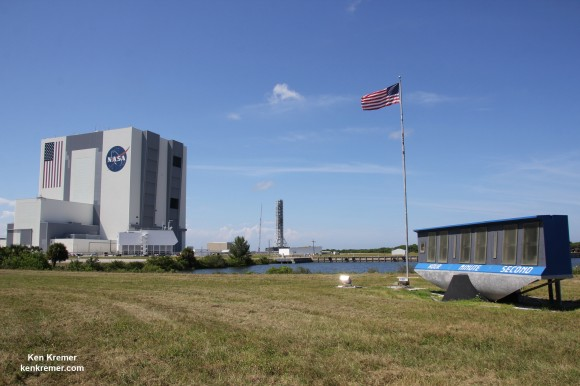 Famous KSC Press Site Countdown Clock and US Flag with VAB during SpaceX CRS-5 launch in September 2014. Credit: Ken Kremer – kenkremer.com