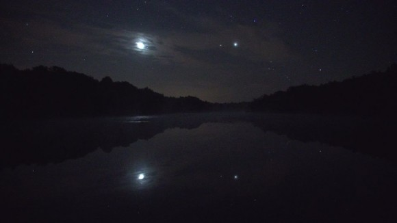 An Iridium flare so bright, it is reflected in a pond. Credit and copyright: Thierry Legault.