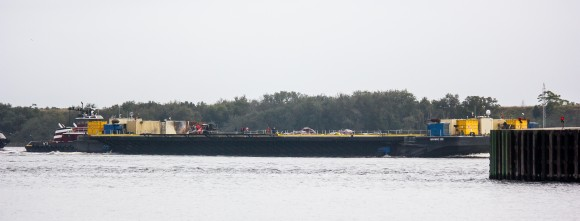 Photo of returning SpaceX 'autonomous spaceport drone ship' shows possible damage to onboard gear and possibly a few rocket parts under tarps. Credit: Reddit